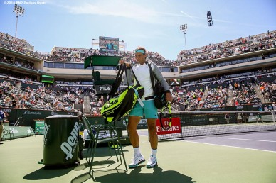 """Rafael Nadal is introduced before the men's semi-final match against Novak Djokovic during the 2016 BNP Paribas Open at the Indian Wells Tennis Garden in Indian Wells, California Saturday, March 19, 2016."""