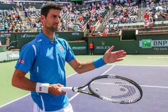 """Novak Djokovic is introduced before the men's semi-final match against Rafael Nadal during the 2016 BNP Paribas Open at the Indian Wells Tennis Garden in Indian Wells, California Saturday, March 19, 2016."""