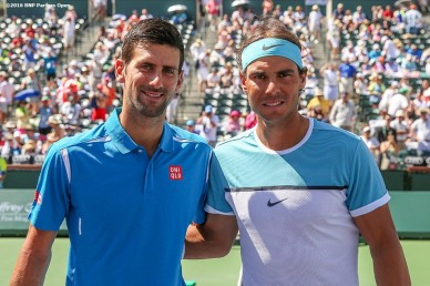 """Coin toss before the men's semi-final match between Novak Djokovic and Rafael Nadal during the 2016 BNP Paribas Open at the Indian Wells Tennis Garden in Indian Wells, California Saturday, March 19, 2016."""