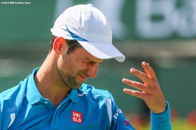 """""""Novak Djokovic in action during the men's semi-final match against Rafael Nadal during the 2016 BNP Paribas Open at the Indian Wells Tennis Garden in Indian Wells, California Saturday, March 19, 2016."""""""
