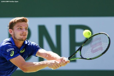 """David Goffin in action against Milos Raonic in the men's semi-final match during the 2016 BNP Paribas Open at the Indian Wells Tennis Garden in Indian Wells, California Saturday, March 19, 2016."""