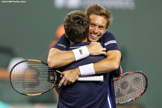 """Nicolas Mahut and Herbert Pierre-Hugues react after winning the men's doubles final against Jack Sock and Vasek Pospisil during the 2016 BNP Paribas Open at the Indian Wells Tennis Garden in Indian Wells, California Saturday, March 19, 2016."""