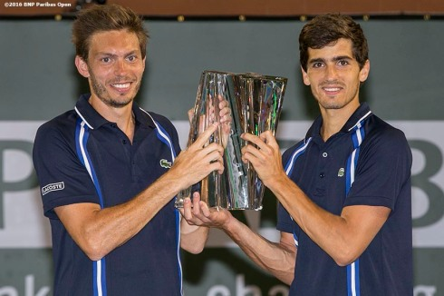"""Trophy presentation following the men's doubles final between Nicolas Mahut and Herbert Pierre-Hugues and Jack Sock and Vasek Pospisil during the 2016 BNP Paribas Open at the Indian Wells Tennis Garden in Indian Wells, California Saturday, March 19, 2016."""