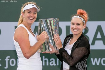 """Trophy ceremony following the women's doubles finals match between Bethanie Mattek-Sands and Coco Vandeweghe and Julia Goerges and Karolina Pliskova during the 2016 BNP Paribas Open at the Indian Wells Tennis Garden in Indian Wells, California Saturday, March 19, 2016."""
