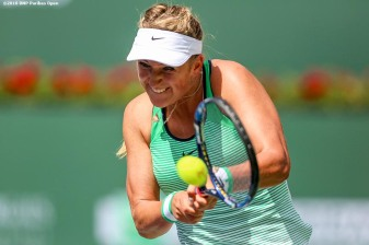 """Victoria Azarenka in action against Serena Williams in the women's finals match during the 2016 BNP Paribas Open at the Indian Wells Tennis Garden in Indian Wells, California Sunday, March 20, 2016."""