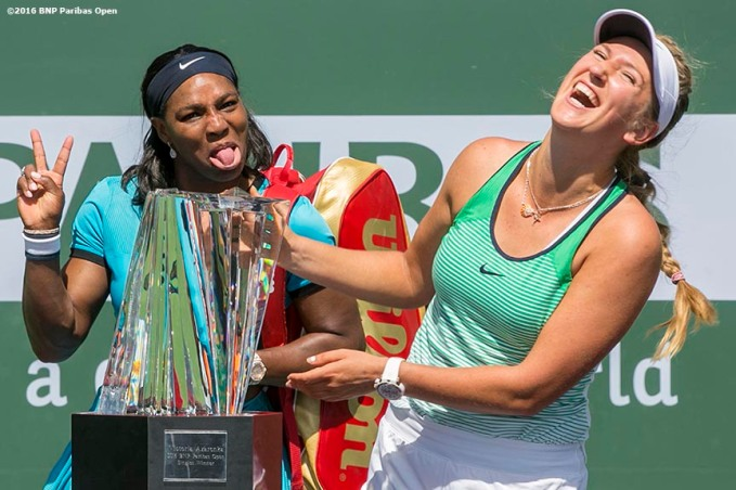"""Trophy presentation following the women's finals match between Victoria Azarenka and Serena Williams during the 2016 BNP Paribas Open at the Indian Wells Tennis Garden in Indian Wells, California Sunday, March 20, 2016."""