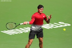 """Milos Raonic in action during the men's finals match against Novak Djokovic during the 2016 BNP Paribas Open at the Indian Wells Tennis Garden in Indian Wells, California Sunday, March 20, 2016."""