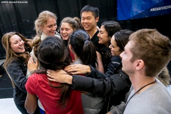 """""""Adrienne Jarocki of the Harvard University women's fencing team reacts with teammates after competing during the 2016 NCAA Fencing Championships at Brandeis University in Waltham, Massachusetts Friday, March 25, 2016."""""""