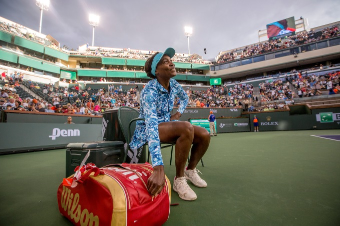 """Venus Williams returns for the first time in 15 years to play Kurumi Nara at the Indian Wells Tennis Garden in Indian Wells, California Friday, March 11, 2016."""