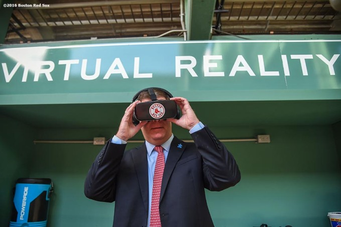 """Boston Mayor Marty Walsh wears goggles as he tests the Boston Red Sox virtual reality dugout during a walk through of Fenway Park in Boston, Massachusetts Friday, April 8, 2016."""
