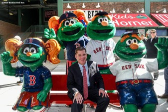 April 8, 2016, Boston, MA: Boston Mayor Marty Walsh poses for a photograph with Boston Red Sox mascots Wally and Tessie on a replica bench during the Mayor's walk through of Fenway Park in Boston, Massachusetts Friday, April 8, 2016. (Photo by Billie Weiss/Boston Red Sox)