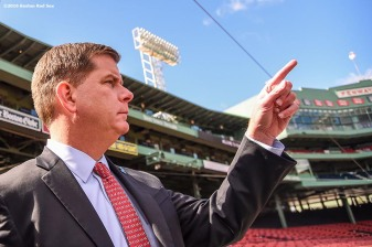 """Boston Mayor Marty Walsh enters the field during a walk through of Fenway Park in Boston, Massachusetts Friday, April 8, 2016."""