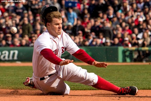 BOSTON, MA - APRIL 11: Brock Holt #12 of the Boston Red Sox slides into third base in the sixth inning against the Baltimore Orioles during the home opener on April 11, 2016 at Fenway Park in Boston, Massachusetts . (Photo by Billie Weiss/Boston Red Sox/Getty Images) *** Local Caption *** Brock Holt
