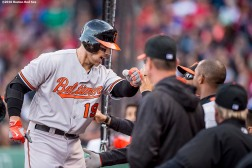 BOSTON, MA - APRIL 11: Chris Davis #19 of the Baltimore Orioles high fives teammates after hitting a three run home run in the ninth inning against the Boston Red Sox during the home opener on April 11, 2016 at Fenway Park in Boston, Massachusetts . (Photo by Billie Weiss/Boston Red Sox/Getty Images) *** Local Caption *** Chris Davis