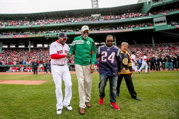 BOSTON, MA - APRIL 11: David Ortiz #34 of the Boston Red Sox, former Boston Celtics player Bill Russell, former New England Patriots player Ty Law, and former Boston Bruins player Bobby Orr walk onto the field to throw a ceremonial first pitch during the home opener against the Baltimore Orioles on April 11, 2016 at Fenway Park in Boston, Massachusetts . (Photo by Billie Weiss/Boston Red Sox/Getty Images) *** Local Caption *** David Ortiz; Bobby Orr; Ty Law; Bill Russell