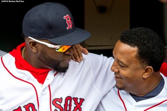 BOSTON, MA - APRIL 11: David Ortiz #34 of the Boston Red Sox and former Boston Red Sox pitcher Pedro Martinez embrace during the home opener against the Baltimore Orioles on April 11, 2016 at Fenway Park in Boston, Massachusetts . (Photo by Billie Weiss/Boston Red Sox/Getty Images) *** Local Caption *** David Ortiz; Pedro Martinez