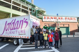 April 16, 2016, Boston, MA: Boston Red Sox mascot Wally the Green Monster poses with RBI League players in front of the Jordan's Furniture truck at Fenway Park during RBI Opening Day in Boston, Massachusetts Saturday, April 16, 2016. (Photo by Billie Weiss/Boston Red Sox)