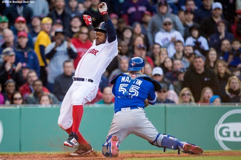 BOSTON, MA - APRIL 16: Hanley Ramirez #13 of the Boston Red Sox avoids the tag of Russell Martin #55 of the Toronto Blue Jays as he scores during the third inning of a game on April 16, 2016 at Fenway Park in Boston, Massachusetts . (Photo by Billie Weiss/Boston Red Sox/Getty Images) *** Local Caption *** Hanley Ramirez; Russell Martin