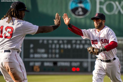 BOSTON, MA - APRIL 16: Dustin Pedroia #15 and Hanley Ramirez #13 of the Boston Red Sox high five during the fourth inning of a game against the Toronto Blue Jays on April 16, 2016 at Fenway Park in Boston, Massachusetts . (Photo by Billie Weiss/Boston Red Sox/Getty Images) *** Local Caption *** Dustin Pedroia; Hanley Ramirez