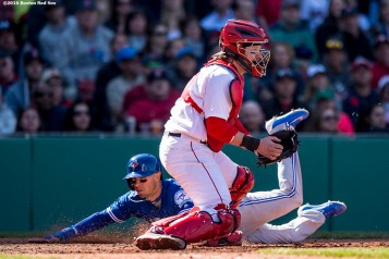 BOSTON, MA - APRIL 17: Ryan Goins #17 of the Toronto Blue Jays avoids the tag of Ryan Hanigan #10 of the Boston Red Sox as he scores during the seventh inning of a game against the Toronto Blue Jays on April 17, 2016 at Fenway Park in Boston, Massachusetts . (Photo by Billie Weiss/Boston Red Sox/Getty Images) *** Local Caption *** Ryan Goins; Ryan Hanigan