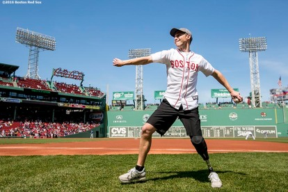BOSTON, MA - APRIL 17: Boston Marathon bombing survivor Patrick Downes warms up to throw a ceremonial first pitch before a game between the Boston Red Sox and the Toronto Blue Jays on April 17, 2016 at Fenway Park in Boston, Massachusetts . (Photo by Billie Weiss/Boston Red Sox/Getty Images) *** Local Caption *** Patrick Downes