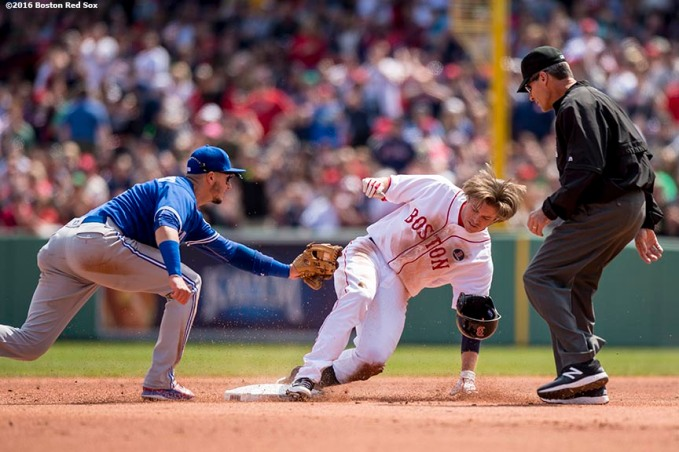 BOSTON, MA - APRIL 18: Josh Rutledge #32 of the Boston Red Sox slides into second base as he avoids the tag of Troy Tulowitzki #2 of the Toronto Blue Jays after hitting an RBI double during the second inning of a game on April 18, 2016 at Fenway Park in Boston, Massachusetts . (Photo by Billie Weiss/Boston Red Sox/Getty Images) *** Local Caption *** Josh Rutledge; Troy Tulowitzki