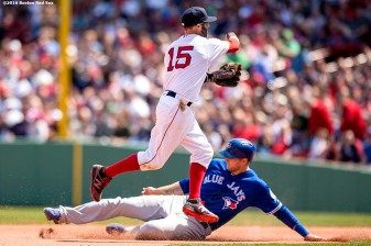 BOSTON, MA - APRIL 18: Dustin Pedroia #15 of the Boston Red Sox turns an unassisted double play as Michael Saunders #21 of the Toronto Blue Jays slides during the sixth inning of a game on April 18, 2016 at Fenway Park in Boston, Massachusetts . (Photo by Billie Weiss/Boston Red Sox/Getty Images) *** Local Caption *** Dustin Pedroia; Michael Saunders