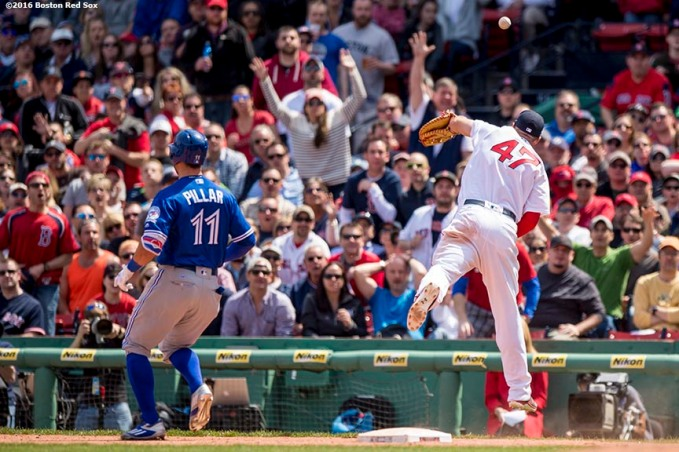 BOSTON, MA - APRIL 18: Travis Shaw #47 of the Boston Red Sox reaches for an overthrown ball from third baseman Josh Rutledge as Kevin Pillar #11 of the Toronto Blue Jays records a single during the eighth inning of a game on April 18, 2016 at Fenway Park in Boston, Massachusetts . (Photo by Billie Weiss/Boston Red Sox/Getty Images) *** Local Caption *** Travis Shaw; Kevin Pillar