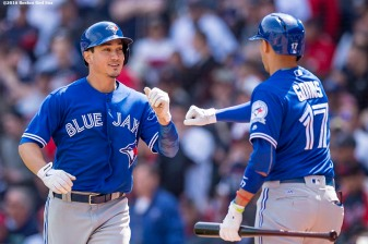 BOSTON, MA - APRIL 18: Darwin Barney #18 of the Toronto Blue Jays high fives Ryan Goins #17 after scoring during the eighth inning of a game against the Boston Red Sox game on April 18, 2016 at Fenway Park in Boston, Massachusetts . (Photo by Billie Weiss/Boston Red Sox/Getty Images) *** Local Caption *** Darwin Barney; Ryan Goins