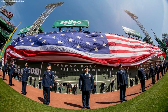 BOSTON, MA - APRIL 18: An American flag is dropped over the Green Monster before a game between the Boston Red Sox and the Toronto Blue Jays on April 18, 2016 at Fenway Park in Boston, Massachusetts . (Photo by Billie Weiss/Boston Red Sox/Getty Images) *** Local Caption ***