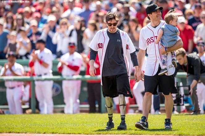 BOSTON, MA - APRIL 18: Boston Marathon bombing survivor Jeff Bauman and actor Jake Gyllenhaal are introduced before throwing out a ceremonial first pitch together before a game between the Boston Red Sox and the Toronto Blue Jays on April 18, 2016 at Fenway Park in Boston, Massachusetts . (Photo by Billie Weiss/Boston Red Sox/Getty Images) *** Local Caption *** Jake Gyllenhall; Jeff Bauman