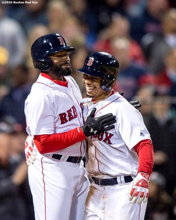 BOSTON, MA - APRIL 20: Mookie Betts #50 reacts with Jackie Bradley Jr. #25 of the Boston Red Sox after hitting a two run home run during the second inning of a game against the Tampa Bay Rays on April 20, 2016 at Fenway Park in Boston, Massachusetts . (Photo by Billie Weiss/Boston Red Sox/Getty Images) *** Local Caption *** Mookie Betts; Jackie Bradley Jr.
