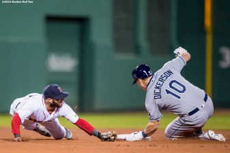 BOSTON, MA - APRIL 20: Dustin Pedroia #2 of the Boston Red Sox attempts to tag Corey Dickerson #10 of the Tampa Bay Rays during the fourth inning of a game against the Tampa Bay Rays on April 20, 2016 at Fenway Park in Boston, Massachusetts . (Photo by Billie Weiss/Boston Red Sox/Getty Images) *** Local Caption *** Corey DIckerson; Dustin Pedroia