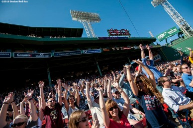 BOSTON, MA - APRIL 21: Fans do the wave during a game between the Boston Red Sox and the Tampa Bay Rays on April 21, 2016 at Fenway Park in Boston, Massachusetts . (Photo by Billie Weiss/Boston Red Sox/Getty Images) *** Local Caption ***