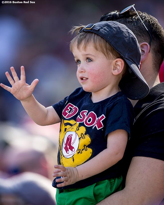 BOSTON, MA - APRIL 21: A young fan waves during a game between the Boston Red Sox and the Tampa Bay Rays on April 21, 2016 at Fenway Park in Boston, Massachusetts . (Photo by Billie Weiss/Boston Red Sox/Getty Images) *** Local Caption ***