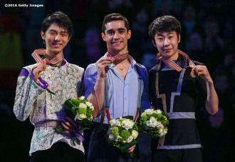 BOSTON, MA - APRIL 1: The medal ceremony for the men's free skate is held with gold medalist Javier Fernandez of Spain, silver medalist Yuzuru Hanyu of Japan, and bronze medalist Boyan Jin of China during Day 5 of the ISU World Figure Skating Championships 2016 at TD Garden on April 1, 2016 in Boston, Massachusetts. (Photo by Billie Weiss - ISU/ISU via Getty Images) *** Local Caption *** Boyan Jin; Yuzuru Hanyu; Javier Fernandez