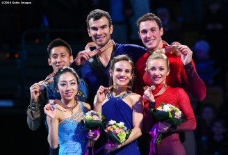 BOSTON, MA - APRIL 2: A medal ceremony is held for the pairs free skating final with gold medalists Meagan Duhamel and Eric Radford of Canada, silver medalists Wenjing Sui and Cong Han of China, and bronze medalists Aliona Savchenko and Bruno Massot of Germany, during Day 6 of the ISU World Figure Skating Championships 2016 at TD Garden on April 2, 2016 in Boston, Massachusetts. (Photo by Billie Weiss - ISU/ISU via Getty Images) *** Local Caption *** Meagan Duhamel; Eric Radford; Wenjing Sui; Cong Han; Aliona Savchenko; Bruno Massot