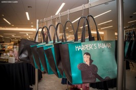 """Harper's Bazaar Magazine bags are shown during the Estee Lauder Fabulous at Every Age event at Saks Fifth Avenue in Boston, Massachusetts Friday, April 22, 2016."""