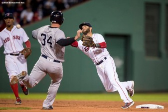 BOSTON, MA - APRIL 30: Dustin Pedroia #15 of the Boston Red Sox turns a double play as Brian McCann #34 of the New York Yankees slides during the fifth inning of a game on April 30, 2016 at Fenway Park in Boston, Massachusetts . (Photo by Billie Weiss/Boston Red Sox/Getty Images) *** Local Caption *** Dustin Pedroia; Brian McCann