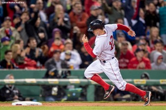 BOSTON, MA - APRIL 30: Brock Holt #12 of the Boston Red Sox rounds third base before scoring during the sixth inning of a game against the New York Yankees on April 30, 2016 at Fenway Park in Boston, Massachusetts . (Photo by Billie Weiss/Boston Red Sox/Getty Images) *** Local Caption *** Brock Holt