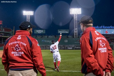 BOSTON, MA - MAY 1: Brock Holt #12 of the Boston Red Sox warms up as members of the grounds crew look on before a game against the New York Yankees on May 1, 2016 at Fenway Park in Boston, Massachusetts. (Photo by Billie Weiss/Boston Red Sox/Getty Images) *** Local Caption *** Brock Holt