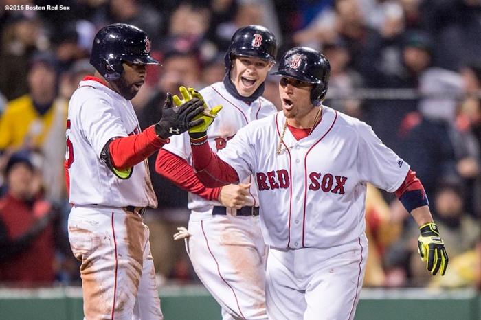 BOSTON, MA - MAY 1: Christian Vazquez #7 of the Boston Red Sox high fives Brock Holt #12 and Jackie Bradley Jr. #25 after hitting a go ahead two run home run during the seventh inning of a game against the New York Yankees on May 1, 2016 at Fenway Park in Boston, Massachusetts. (Photo by Billie Weiss/Boston Red Sox/Getty Images) *** Local Caption *** Christian Vazquez; Brock Holt, Jackie Bradley Jr.