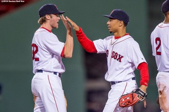 BOSTON, MA - MAY 10: Mookie Betts #50 of the Boston Red Sox high fives Josh Rutledge #32 after defeating the Oakland Athletics on May 10, 2016 at Fenway Park in Boston, Massachusetts. (Photo by Billie Weiss/Boston Red Sox/Getty Images) *** Local Caption *** Mookie Betts; Josh Rutledge
