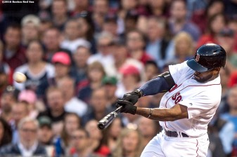 BOSTON, MA - MAY 11: Jackie Bradley Jr. #25 of the Boston Red Sox hits a three run home run during the third inning of a game against the Oakland Athletics on May 11, 2016 at Fenway Park in Boston, Massachusetts. (Photo by Billie Weiss/Boston Red Sox/Getty Images) *** Local Caption *** Jackie Bradley Jr.