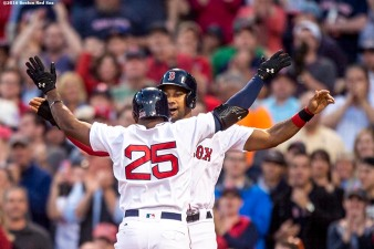 BOSTON, MA - MAY 11: Jackie Bradley Jr. #25 of the Boston Red Sox high fives Chris Young #30 after hitting a three run home run during the third inning of a game against the Oakland Athletics on May 11, 2016 at Fenway Park in Boston, Massachusetts. (Photo by Billie Weiss/Boston Red Sox/Getty Images) *** Local Caption *** Jackie Bradley Jr.; Chris Young