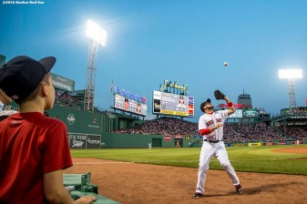BOSTON, MA - MAY 11: Travis Shaw #47 of the Boston Red Sox catches a foul ball as a fan looks on during the third inning of a game against the Oakland Athletics on May 11, 2016 at Fenway Park in Boston, Massachusetts. (Photo by Billie Weiss/Boston Red Sox/Getty Images) *** Local Caption *** Travis Shaw