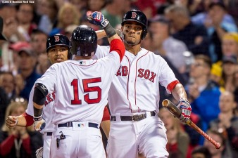 BOSTON, MA - MAY 11: Dustin Pedroia #15 of the Boston Red Sox high fives Xander Bogaerts #2 and Mookie Betts #50 after hitting a two run home run during the fourth inning of a game against the Oakland Athletics on May 11, 2016 at Fenway Park in Boston, Massachusetts. (Photo by Billie Weiss/Boston Red Sox/Getty Images) *** Local Caption *** Dustin Pedroia; Xander Bogaerts; Mookie Betts
