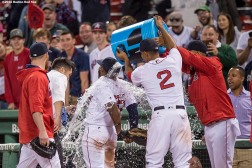BOSTON, MA - MAY 11: Xander Bogaerts #2 dumps gatorade on Jackie Bradley Jr. #25 of the Boston Red Sox following a victory against the Oakland Athletics on May 11, 2016 at Fenway Park in Boston, Massachusetts. It was his second home run of the night. (Photo by Billie Weiss/Boston Red Sox/Getty Images) *** Local Caption *** Jackie Bradley Jr.; Brock Holt