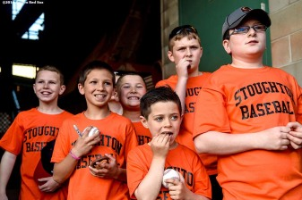 BOSTON, MA - MAY 11: Members of the Stoughton Little League react before running onto the field before a game between the Boston Red Sox and the Oakland Athletics on May 11, 2016 at Fenway Park in Boston, Massachusetts. The little leaguers took the field as part of the Major League Baseball Play Ball Initiative. (Photo by Billie Weiss/Boston Red Sox/Getty Images) *** Local Caption ***