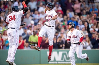 BOSTON, MA - MAY 12: Xander Bogaerts #2 of the Boston Red Sox high fives David Ortiz #34 after hitting a two run home run during the first inning of a game against the Houston Astros on May 12, 2016 at Fenway Park in Boston, Massachusetts. (Photo by Billie Weiss/Boston Red Sox/Getty Images) *** Local Caption *** Xander Bogaerts; David Ortiz